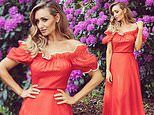 Catherine Tyldesley oozes glamour as she poses in a vintage off-the-shoulder red dress