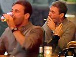Jon Hamm swigs beer and smokes cigarettes while taking break from promoting film with Clint Eastwood