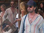 Gerard Butler enjoys the company of a bevy of beauties during a holiday in the sun in Mexico