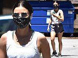 Lucy Hale shows off her fit physique in a tank top and grey shorts as she embarks on a hike