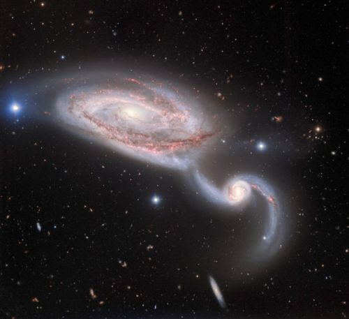 A captivating view of the Heron Galaxy as a gravitational tug of war plays out