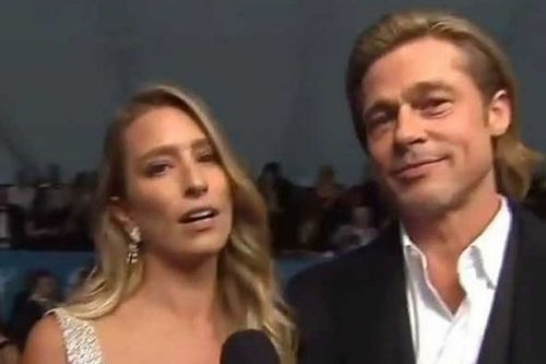 Brad Pitt 'romantically linked to Aussie TV host who denies dating Tom Cruise'