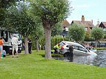 Driver is rescued after car careers into lake at Suffolk beauty spot
