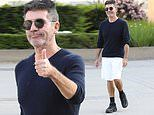 Simon Cowell is upbeat as he arrives for AGT filming in black sweater and white shorts