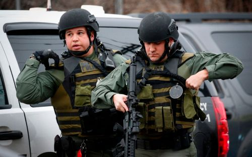 New Jersey gun battle leaves six dead as police battletwo men with high-powered rifles