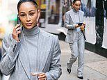 Cara Santana means business in Ralph Lauren pantsuit as she takes calls and grabs coffee