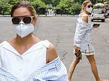 Olivia Palermo cuts a chic summer look as she carries her shoes after getting pedicure in Brooklyn