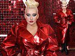 Christina Aguilera amps up the glamour in a shimmering red metallic trench coat and platform boots