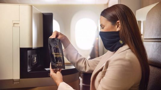 Etihad introduces snood style facemasks for premium passengers