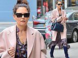 Katie Holmes models an oversized dusty pink coat over a ruffled plaid dress