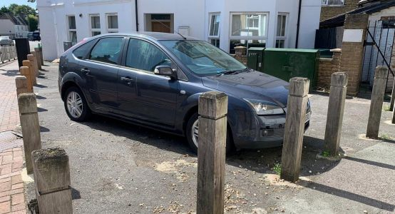 Driver finds car surrounded by bollards that were erected while he was away
