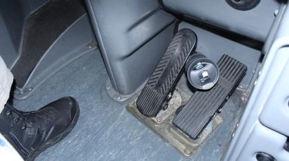 A thermos jammed between gas and brake pedals may have caused fatal bus accident