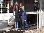 Family risk their lives to line up for group selfie on level crossing in shocking video