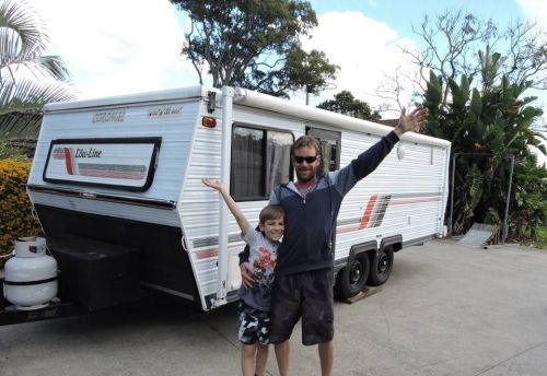 Single dad, 35, quits rat race to spend quality time with autistic son, 10, travelling around Australia in caravan