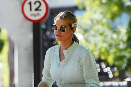 Stylish Vogue Williams takes Gigi and Theodore out for stroll in double buggy