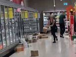 Bizarre moment Woolworths staff hurl boxes down supermarket aisles to speed up restocking process