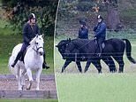 Prince Andrew and Lady Louise Windsor, 17, go for a horse ride on the grounds as Windsor Castle