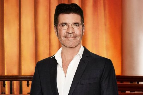 Simon Cowell tweets from hospital for first time after six-hour spinal surgery