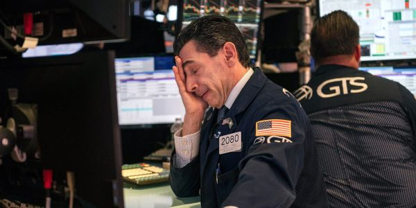 Dow drops 200 points as traders mull Biden's stimulus plan and soft retail-sales data