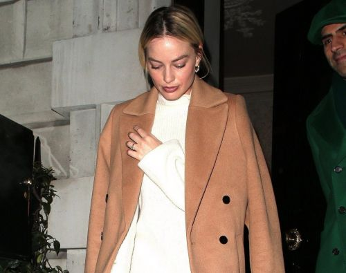 Margot Robbie keeps head down after skipping Oscars luncheon to party in London