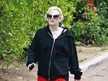 Rebel Wilson shows off her 30kg weight loss in a pair of bright red cheetah print leggings