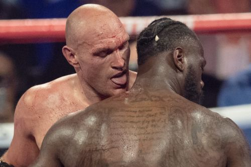 Tyson Fury licks Deontay Wilder's BLOOD during fight shocking live TV viewers after brutal war