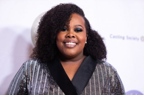 Glee star Amber Riley confirms she is 'happily engaged' to boyfriend Desean Black