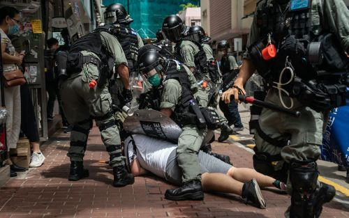 Hong Kong protests: Police arrest man at airport after stabbing of officer as clashes over new law spill into second day