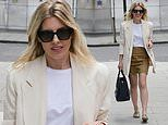 Mollie King puts on a VERY leggy display in a tan mini skirt paired with a chic cream blazer