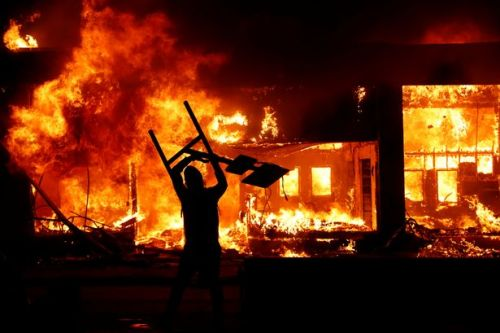 Fires across US amid justice for George Floyd protests as policeman arrested