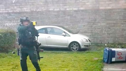 Pictured: Moment cops prepare to Taser man armed with pitchfork