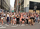 Fandemonium! Fashionistas flock to Times Square to watch Sex And The City stars film latest drama
