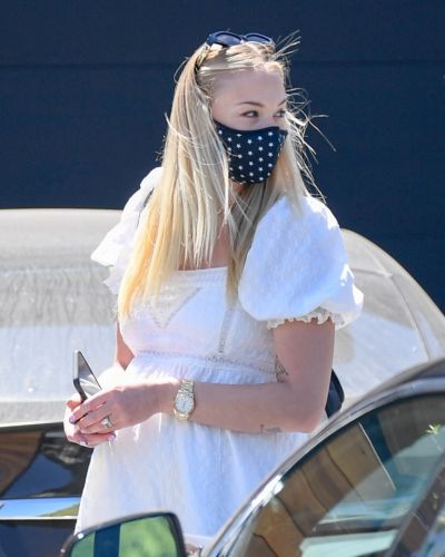 Pregnant Sophie Turner shows off growing baby bump in short dress while holding hands on walk with Joe Jonas
