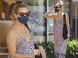 Kate Hudson goes braless in a back-baring romper as she takes a solo shopping trip after engagement