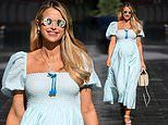 Pregnant Vogue Williams is the picture of summer in a powder blue midi dress as she leaves Heart FM