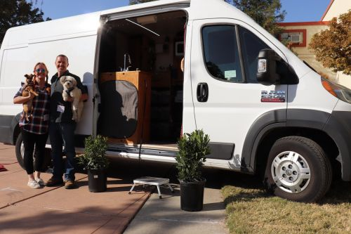 A couple lives full-time in a 72-square-foot van with their two dogs so they can pay off debts and travel: 'We've been dreaming of this for many years'