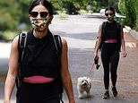 Lucy Hale teases a glimpse of her toned midriff in crop-top on hike with dog Elvis