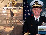 Sacked aircraft carrier captain is given a standing ovation by his crew as he walks off warship