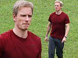 Michael Fassbender steps on to the pitch as real life soccer coach Thomas Rongen in Next Goal Wins