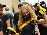 Fans arrive at The Gabba for a soaking AFL Grand Final between Richmond Tigers and Geelong Cats