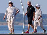 Laid-back Bill and Hillary Clinton take causal stroll on beach in the Hamptons