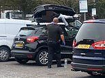 Moment police catch 'illegal migrant' stowed inside roof box on family's car at M20 service