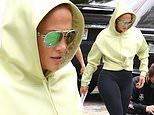 Jennifer Lopez goes neon chic in green at studio in Miami. after revealing music with Maluma