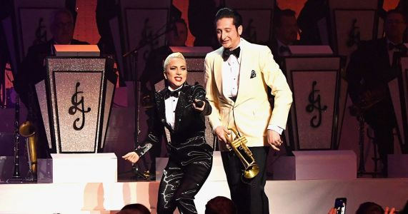 Lady Gaga surprises fans by kissing 'married' trumpet player Brian Newman on-stage in Las Vegas