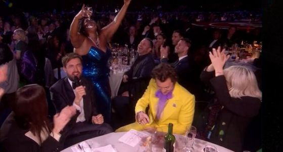 Harry Styles And Lizzo Deliver Moment Of The Brit Awards As She Necks His Wine Glass Of Tequila