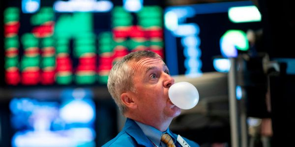 An expert who called the dotcom crash says Wall Street is recycling tech-bubble tactics to justify the record-shattering stock rally - and warns it's an 'accident waiting to happen'