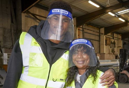 Marcus Rashford takes his mum to food charity after MPs rejected free school meals