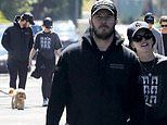 Chris Pratt and wife Katherine Schwarzenegger match in black as they take a walk with family