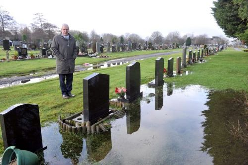 Distressed husband says there is no dignity in death because of flooded graves at Paisley cemetery