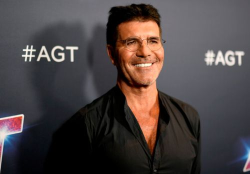 Simon Cowell keeps in good spirits as he speaks out after breaking back in freak bike accident